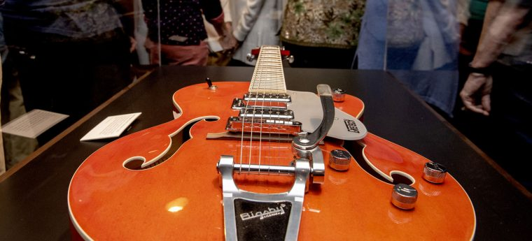 Bigsby 6-string electric guitar in a museum glass case