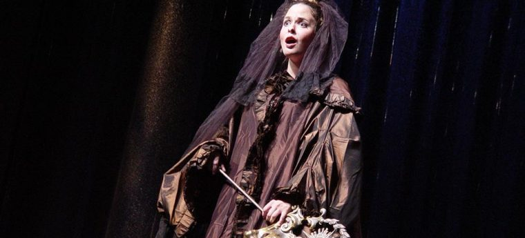 Woman soprano singer dressed in the role of the Governess in Benjamin Britten's The Turn of the Screw